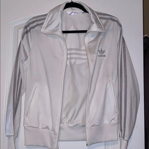White and silver Adidas track suit